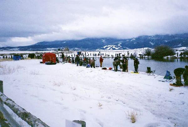 Fishermen line the shores during the Soda Springs Fishing Derby.