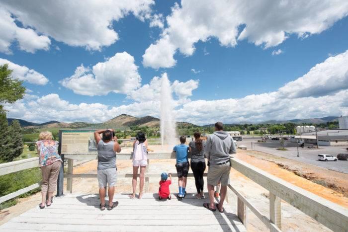people standing at soda springs geyser