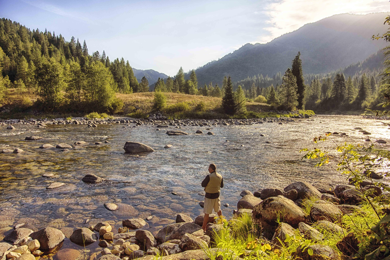 Husband fishing in river.