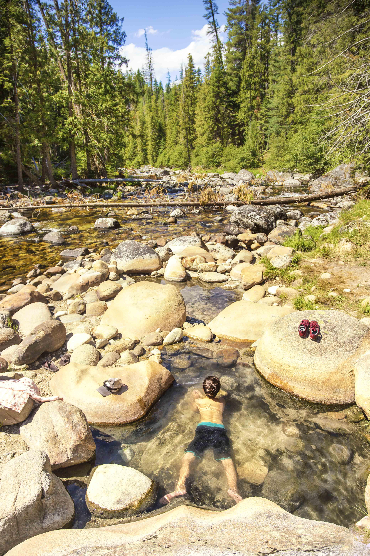 Soaking in a riverside natural hot pool.