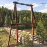 Wooden foot bridge across the river.