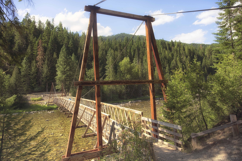 Wooden foot bridge across the river.