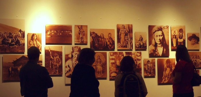 People viewing a Nez Perce photo display