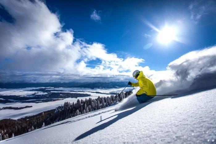 A skier headed down a ski run.