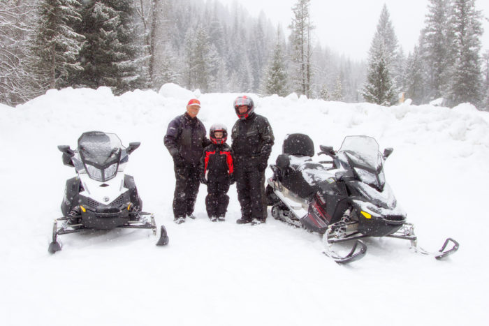 Snowmobiles and riders at the ready.