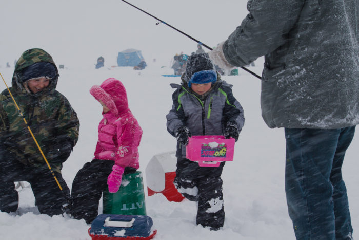 Two kids getting ready to fish at the Idaho Youth Outdoors: 7th Annual Youth Ice Fishing Day.