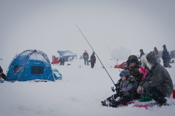 A family hoping to catch some Perch at the Idaho Youth Outdoors: 7th Annual Youth Ice Fishing Day.
