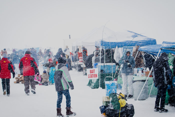 People grabbing supplies at the Idaho Youth Outdoors: 7th Annual Youth Ice Fishing Day.
