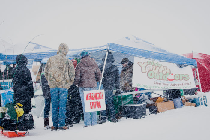 Youth getting bait from the supply station at the Idaho Youth Outdoors: 7th Annual Youth Ice Fishing Day.