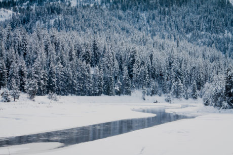 A river winding through a snowy valley.