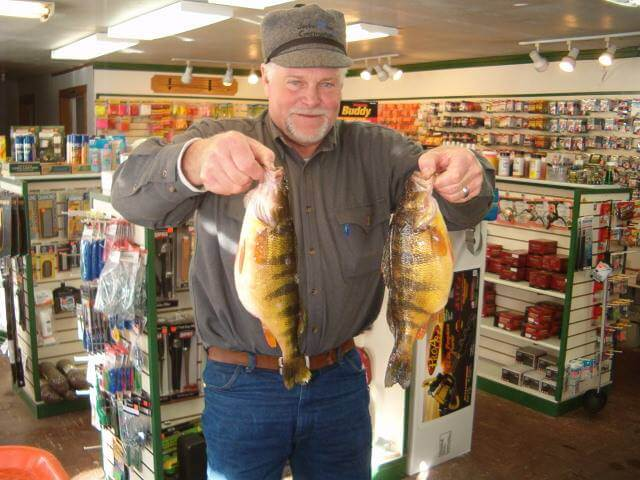 Kevin Grover showing off his prized cathes at Tackle Tom's: Fishing and Outdoor Equipment