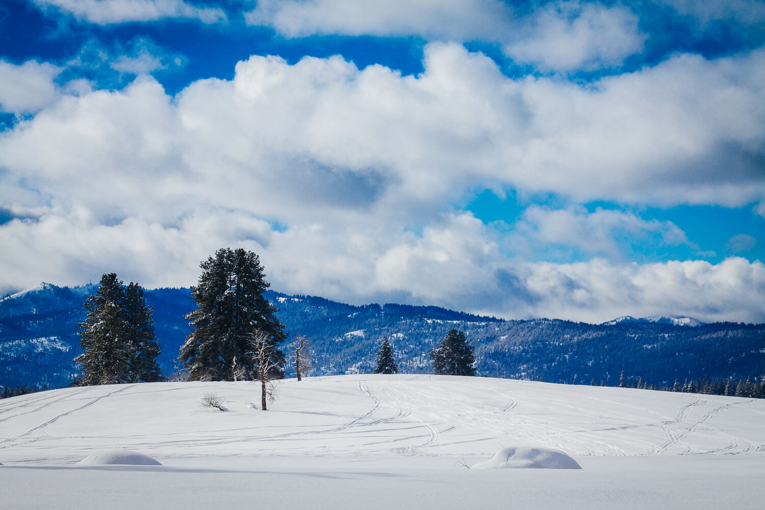 A mountainous landscape in the winter.