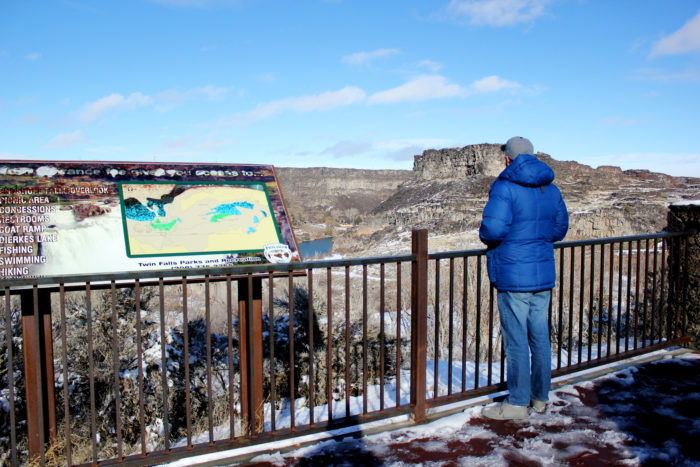 Man looking out into Shoshone Falls