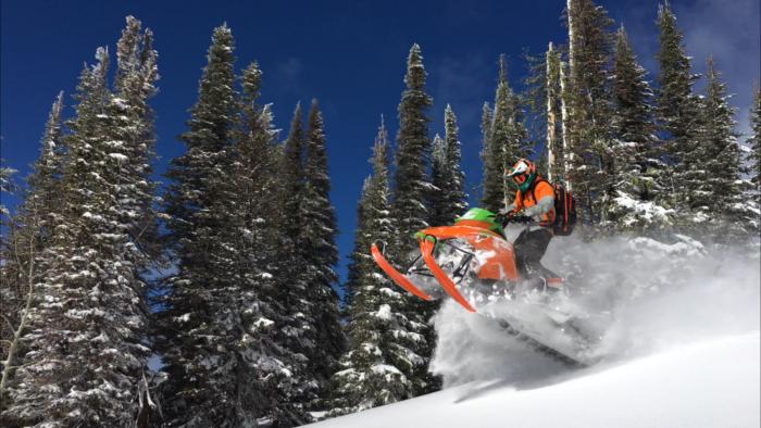 A snowmobiler exploring backcountry.
