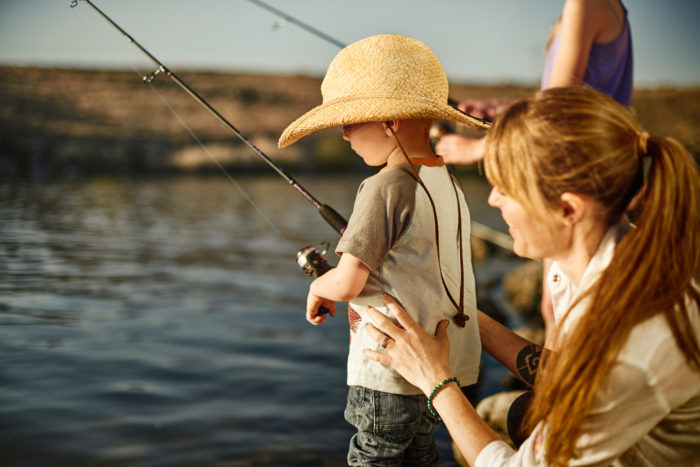 A child and mother fishing.