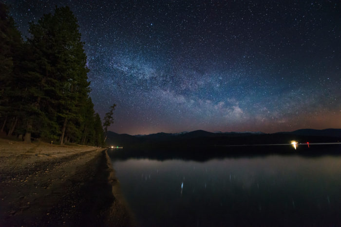 The Milky Way rises over a campground.