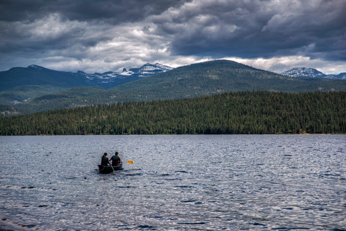 Two people in a canoe on a lake.