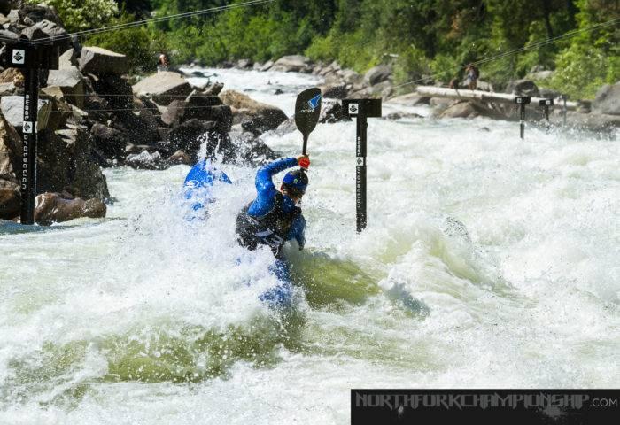 Kayaker on big whitewater.