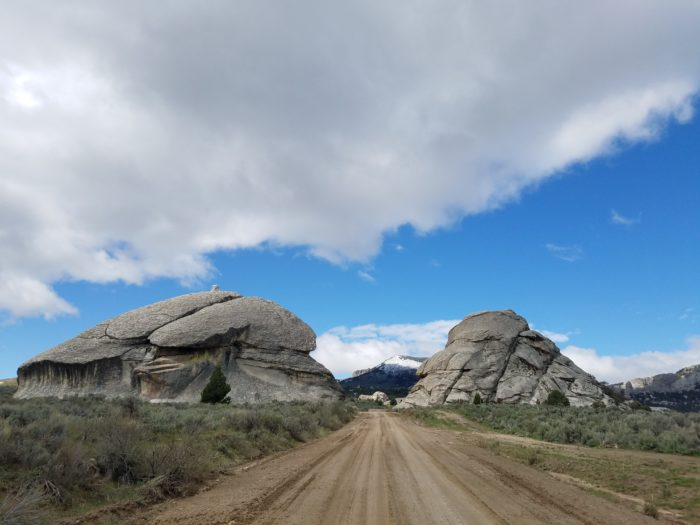 Two giant rocks with a road between them.