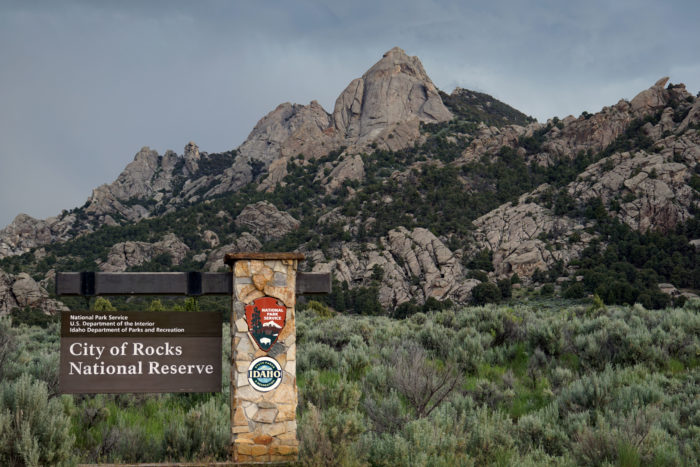 large rock structures with entrance sign to city of rocks