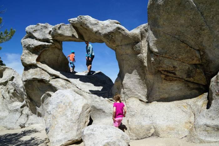 family climbs rocks