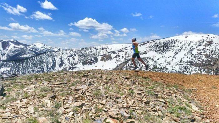 man running along mountain ridge