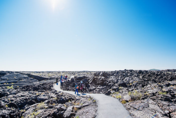 A family walking on a trail at Craters of the Moon.