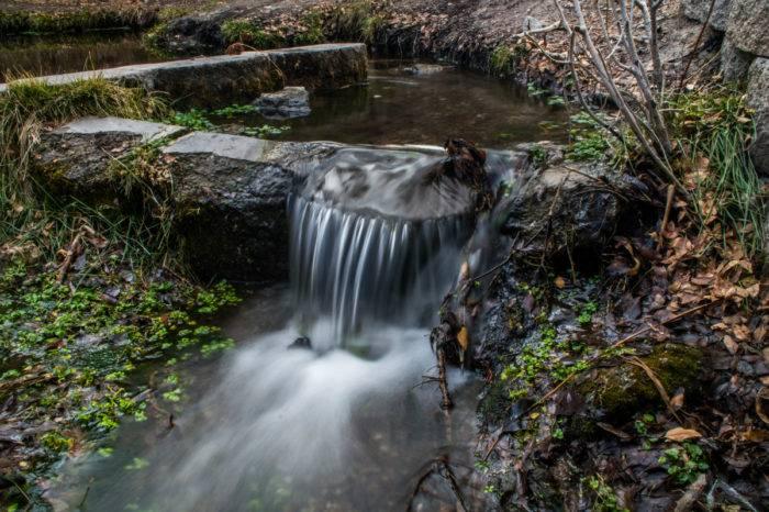 small waterfall along nature trail.