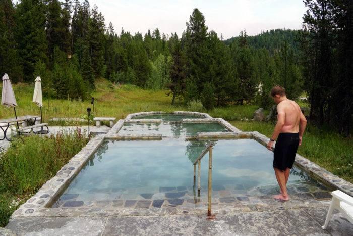man walking into hot pools