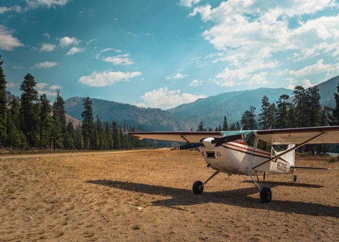 small airplane at backcountry airstrip