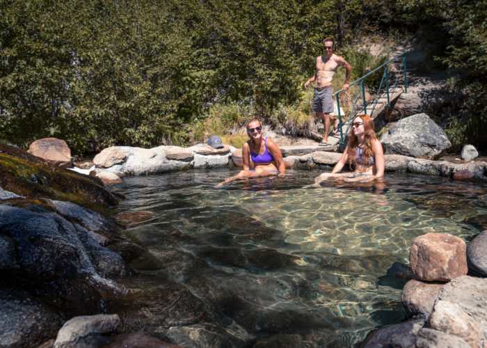 3 people in a natural hot pool