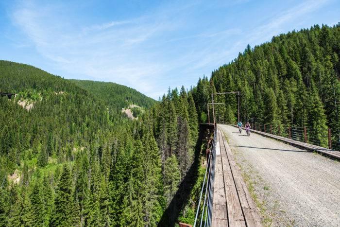 Riding over a trestle bridge on the Route of the Hiawatha