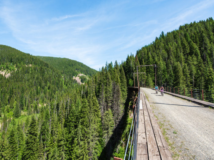 Riding over a trestle bridge on the Route of the Hiawatha. Photo Credit: Idaho Tourism