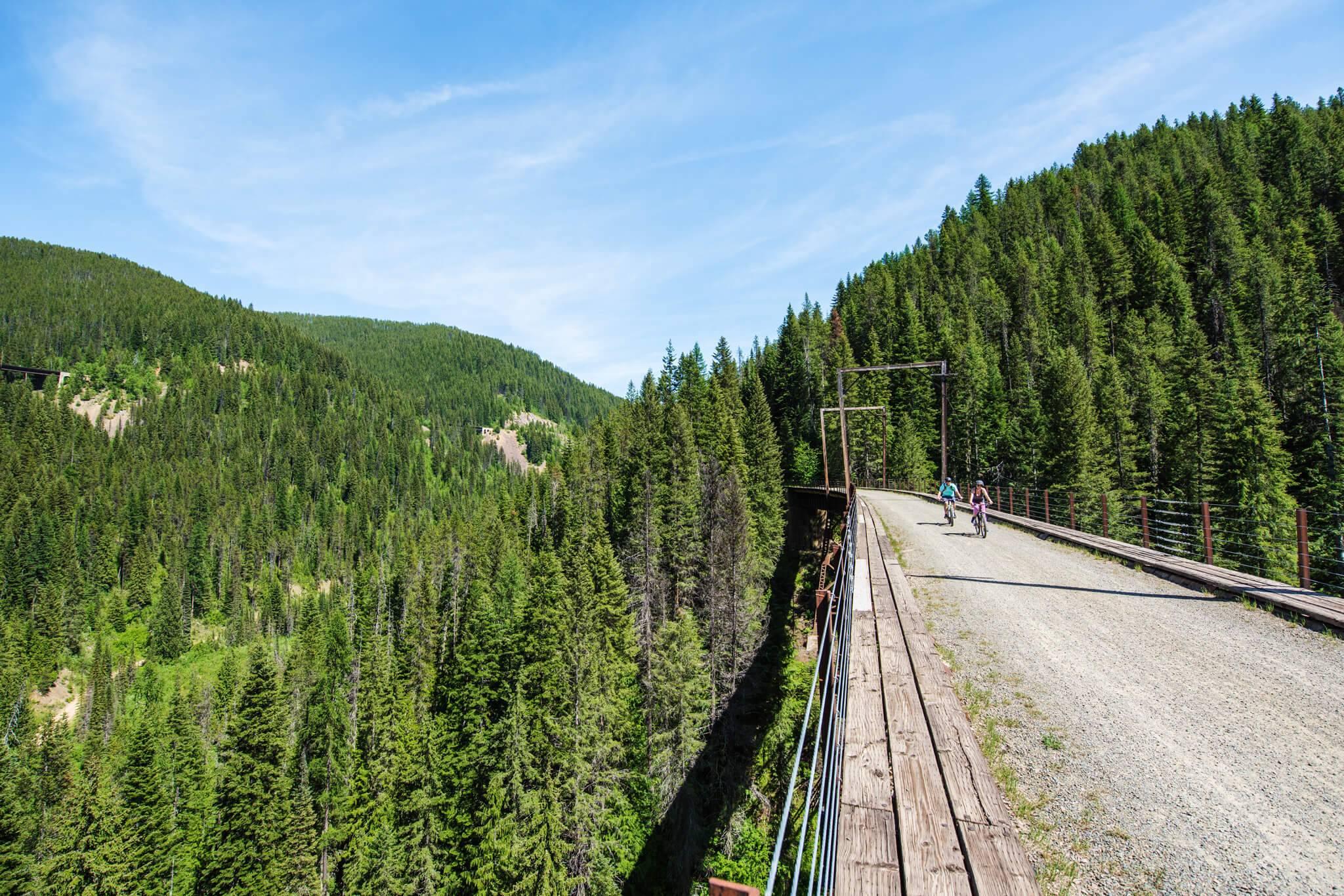 Riding over a trestle bridge on the Route of the Hiawatha. Photo Credit: Idaho Tourism