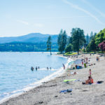 Soaking up the sun at City Park & Beach in Coeur d'Alene. Photo Credit: Idaho Tourism