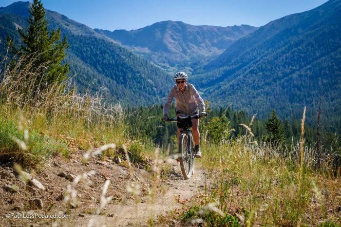 mountain biker riding through the mountians