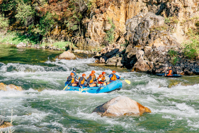 rafters going through rapids on the river