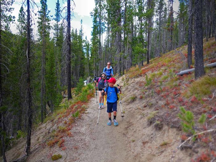 family hiking on a mountain trail
