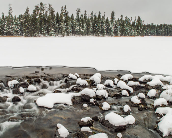 snowy creek surrounded by snow
