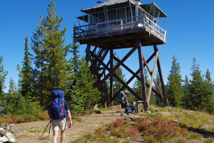 Hikers walking to a fire lookout.