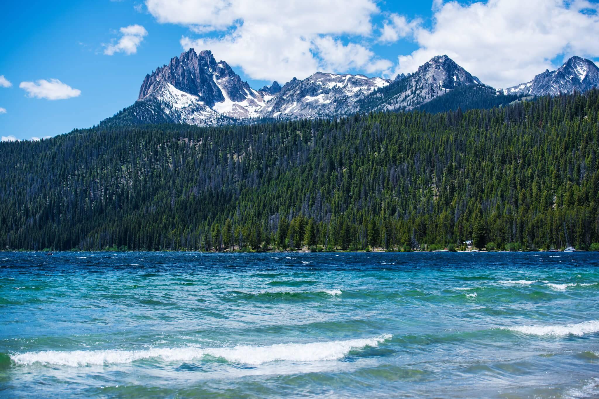 Waves crash on the beach of Redfish Lake. Photo Credit: Idaho Tourism
