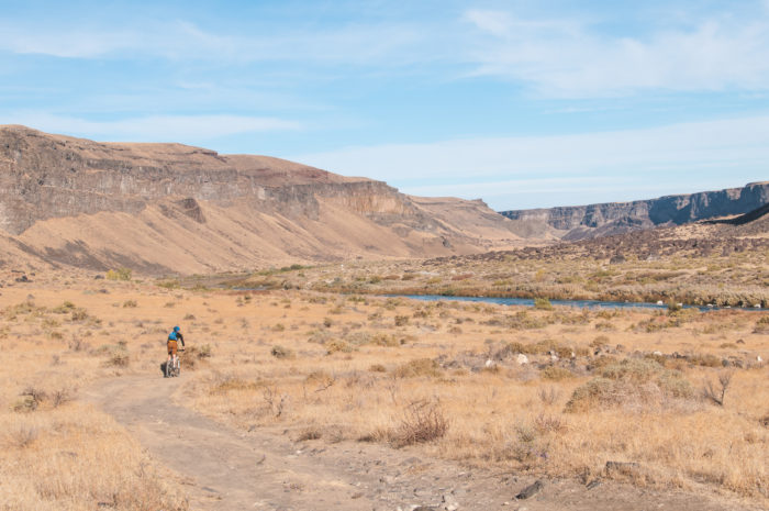 cyclist in desert canyon