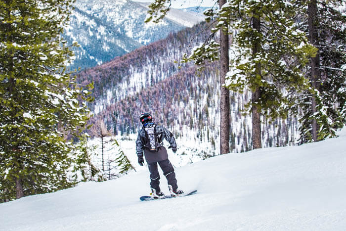snowboarder on snowy mountain