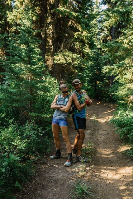 two runners on a mountain trail