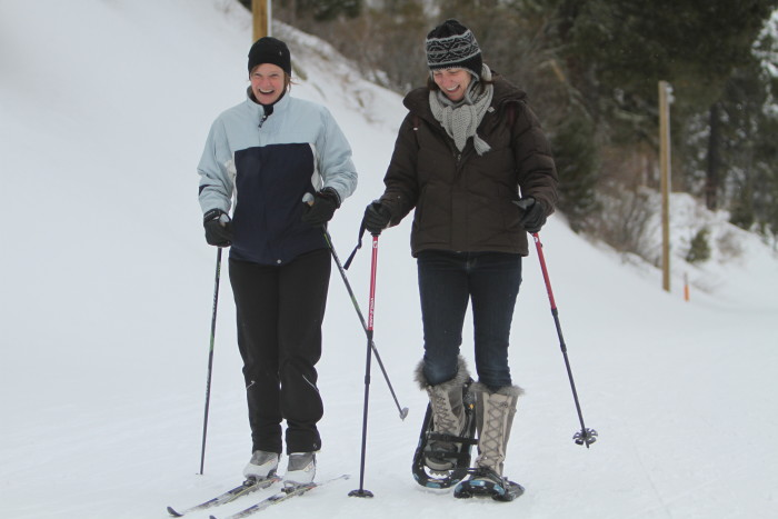 Female cross country skier and snowshoer on the trail at Bogus Basin.