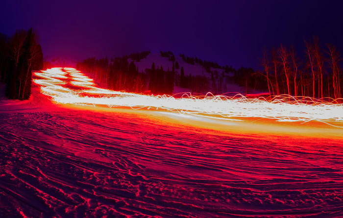 Light trail leftover from torchlight parade at night at Targhee Resort