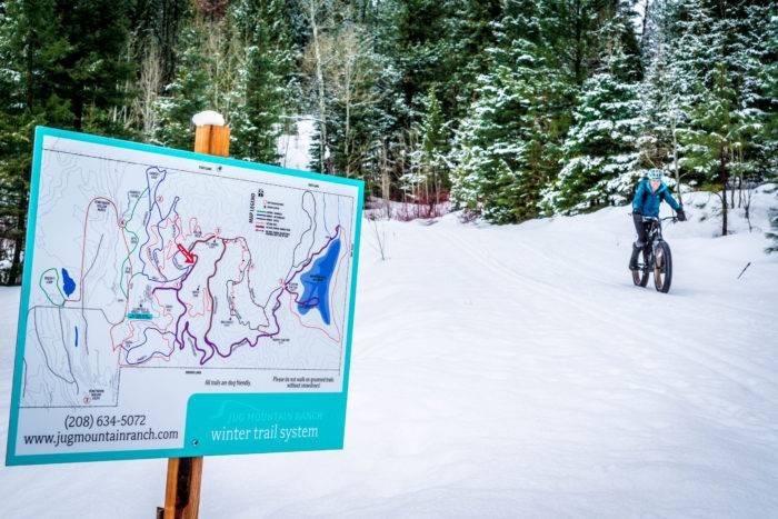 fat bike rider near trail sign
