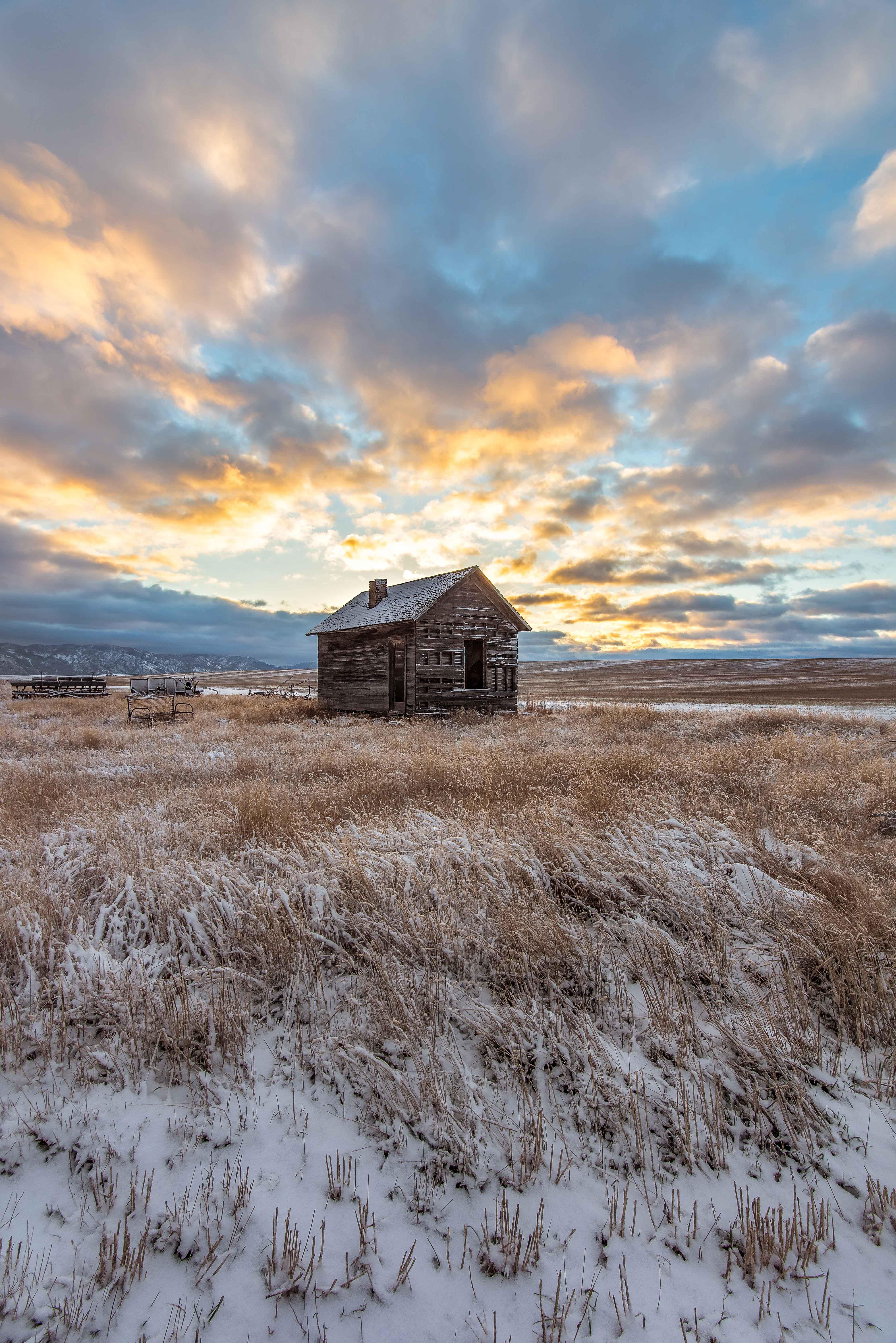 snowy barn in a field