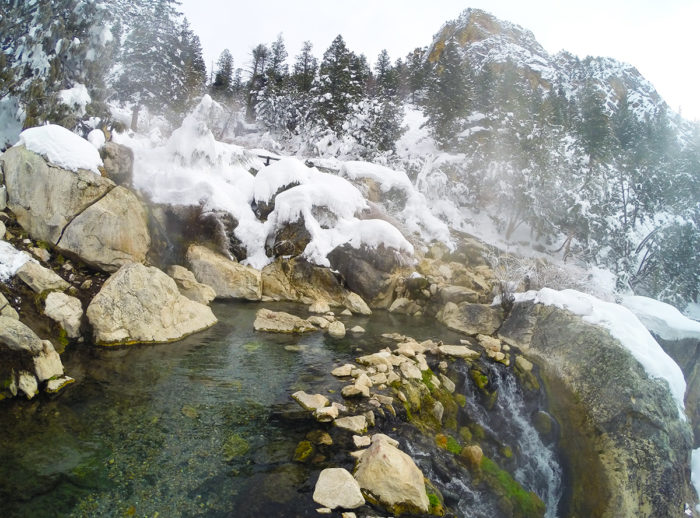 scenic mountain hot pool in the snow.