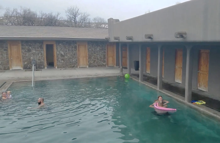 people lounging in a commercial hot pool